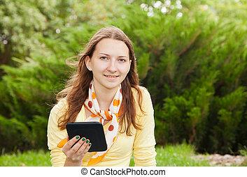 Teen girl reading electronic book