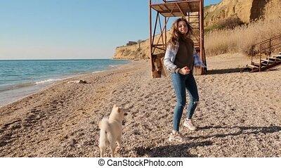 Teen girl run and play ball with her shiba inu beautiful pet...