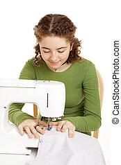 Teen Girl Sewing