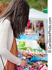 Teen girl shopping outdoor bazaar in Thailand - Biracial...