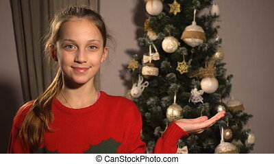 Teen girl show something on her hand