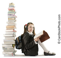 Teen girl sitting at a stack of books