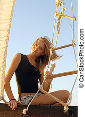girl sitting at stern of the ship