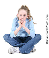 Casual teen crossed legged in shirt and jeans thinking. Over white. Shot with the Canon 20D.