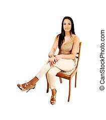 Teen girl sitting.