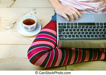 laptop - Teen girl sitting with a laptop