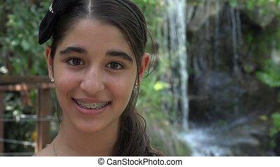 Teen Girl Smiliing in Nature