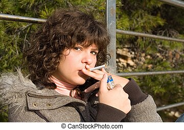 teen girl smoking cigarette