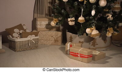 Teen girl stealing gifts under Christmas tree