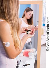 Teen girl taking diabetes medications