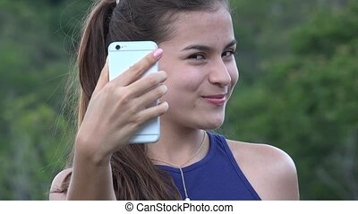 Teen Girl Taking Selfy With Cell Phone