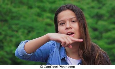 Teen Girl Talking And Giving Directions