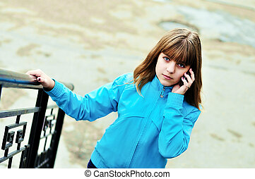 teen girl talking by mobile