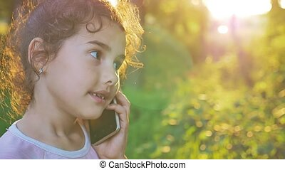 teen girl talking on the phone behind the sunset golden hour nature forest outdoors slow motion video