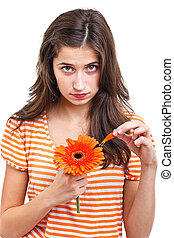 Teen girl telling fortunes with orange flower