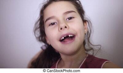 teen girl toothless smile makes selfie