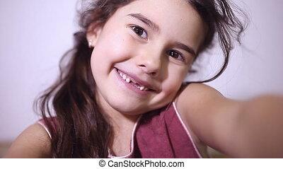 teen girl toothless smile selfie makes