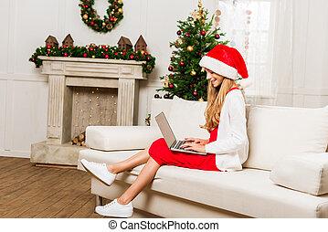 teen girl using laptop
