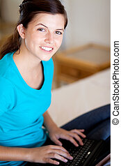 teen girl using laptop computer