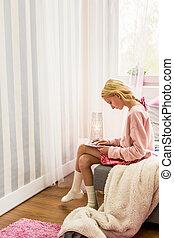 Teen girl using tablet