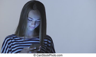 Teen girl using typing in smart phone