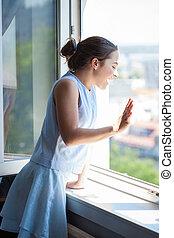 teen girl wave on window
