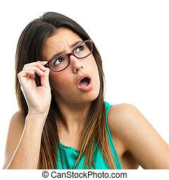 Teen girl wearing glasses looking at corner.