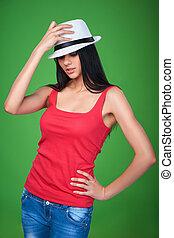Teen girl wearing straw hat looking up