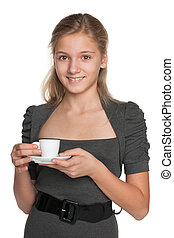 Teen girl with a cup of coffee