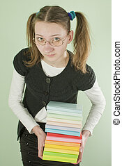 Teen girl with a stack of books