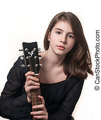 Teen girl with acoustic guitar