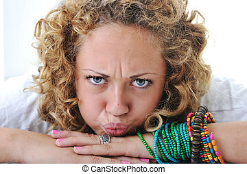 Teen girl with angry grimace