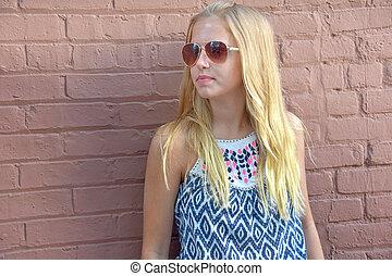 teen girl with aviator sunglasses