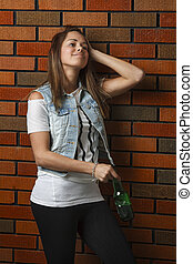 Teen girl with beer
