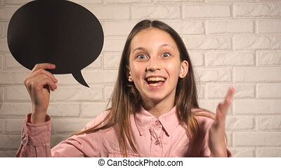 Teen girl with black talking cloud happy telling about...