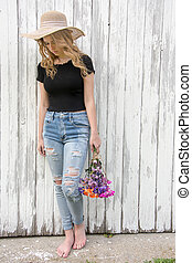 teen girl with frayed blue jeans