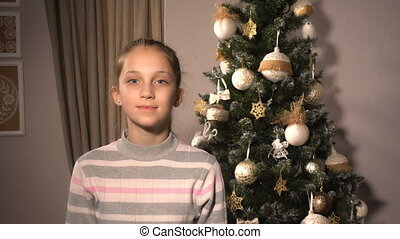 Teen girl with funny Santa hat and beard