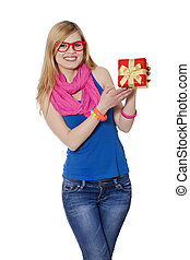 Teen girl with gift at white background
