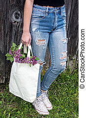 teen girl with lilacs in sack