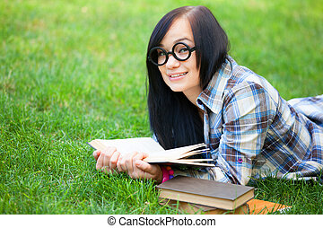 Teen girl with notebook in the park.