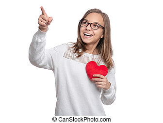Teen girl with red heart