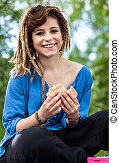 Teen girl with sandwich