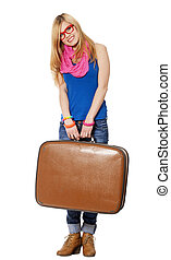 Teen girl with suitcase at white background