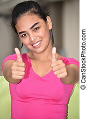 Teen Girl With Thumbs Up