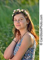 teen girl with wreath