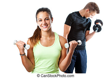Teen girl working out with boy in background.