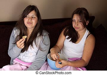 Teen girls eating junk food