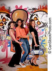 Teen girls graffiti wall