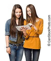 Teen girls sharing a tablet computer.