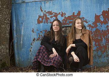 Teen girls sitting